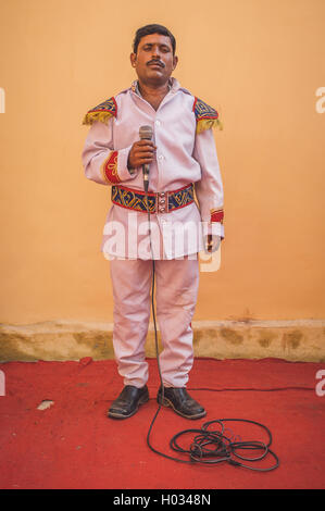 GODWAR REGION, INDIA - 15 FEBRUARY 2015: Indian musician dressed in wedding ceremony outfit holds microphone. Post - Stock Photo