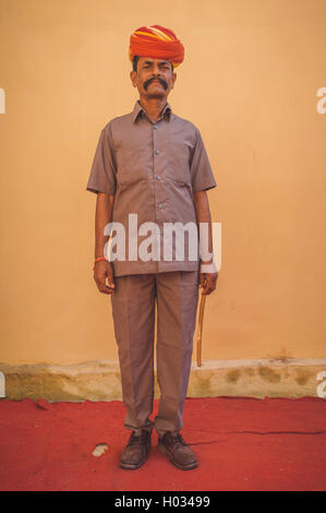 GODWAR REGION, INDIA - 15 FEBRUARY 2015: Indian musician dressed in wedding ceremony outfit holds stick. Post-processed - Stock Photo