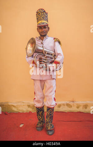 GODWAR REGION, INDIA - 15 FEBRUARY 2015: Indian musician dressed in wedding ceremony outfit holds trumpet. Post - Stock Photo