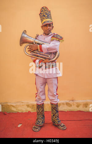 GODWAR REGION, INDIA - 15 FEBRUARY 2015: Young Indian musician dressed in wedding ceremony outfit holds trumpet. - Stock Photo