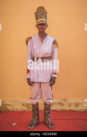 GODWAR REGION, INDIA - 15 FEBRUARY 2015: Young Indian musician dressed in wedding ceremony outfit with tall hat. - Stock Photo