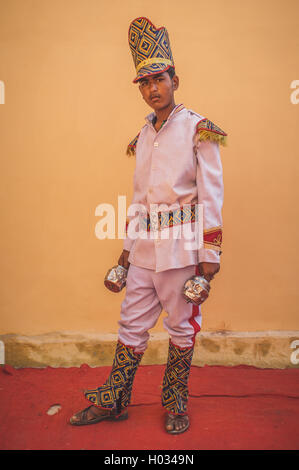 GODWAR REGION, INDIA - 15 FEBRUARY 2015: Young Indian musician dressed in wedding ceremony outfit holds instrument. - Stock Photo