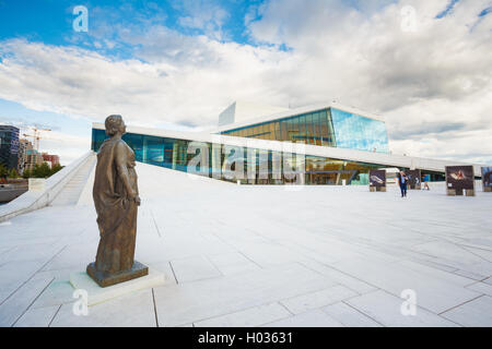 Oslo, Norway - July 31, 2014: Side View Of Glass Facade Of Oslo Opera And Ballet House. The Bronze Statue On White - Stock Photo