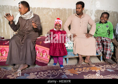 ASWAN, EGYPT - FEBRUARY 7, 2016: Local family from Nubian village on the Nile in their home. - Stock Photo