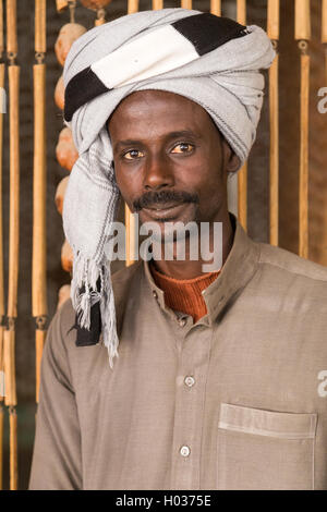 DARAW, EGYPT - FEBRUARY 6, 2016: Portrait of local man with turban. - Stock Photo