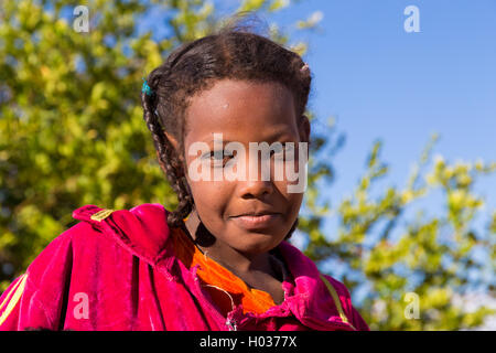 ASWAN, EGYPT - FEBRUARY 7, 2016: Portrait of Nubian girl. - Stock Photo