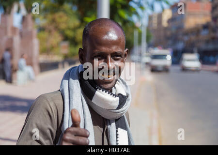 ASWAN, EGYPT - FEBRUARY 6, 2016: Portrait of smiling local man showing thumbs up. - Stock Photo