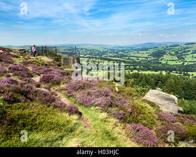 View over Wharfedale from the Swastika Stone at Woodhouse Crag Ilkley Moor West Yorkshire England - Stock Photo