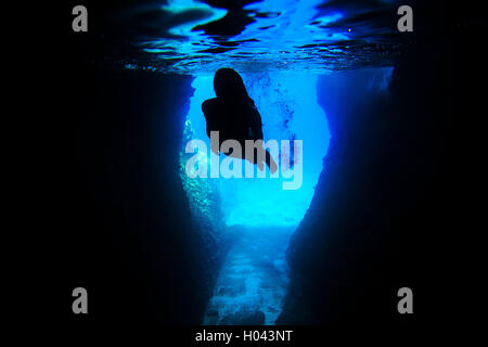 Underwater photo of woman snorkeling - Stock Photo