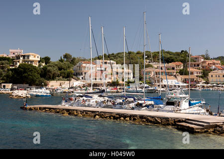 Sailing yachts moored at the entrance to  Kassiopi Harbour in northeast Corfu, The Ionian Islands, The Greek Islands, - Stock Photo