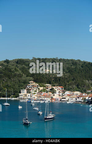 Sailing yachts moored in Lakka harbour on Paxos, The Ionian Islands, The Greek Islands, Greece, Europe - Stock Photo