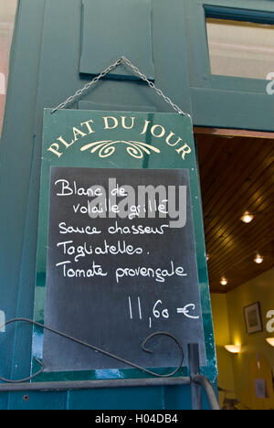 'Plat du Jour' blackboard menu with euros fixed price hanging outside French restaurant St-Émilion, Gironde, France - Stock Photo