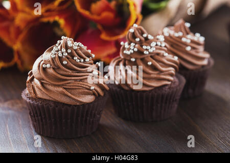 Delicious Mothers day  chocolate cupcakes  with spring tulips - Stock Photo