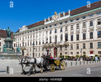 Horse & carriage in front of  the Imperial Chancellory Wing in the Internal Castle Square, Hofburg Palace, Vienna, - Stock Photo