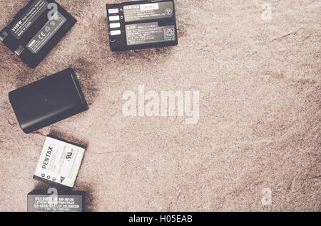 spare camera batteries on a stone worktop - copy space - Stock Photo