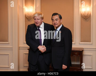 New York, USA. 19th Sep, 2012. Chinese Foreign Minister Wang Yi (R) meets with British Foreign Secretary Boris Johnson - Stock Photo