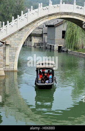 Beijing, China. 17th Sep, 2016. Tourists take a boat to view Gubei water town in the Miyun District of Beijing, - Stock Photo