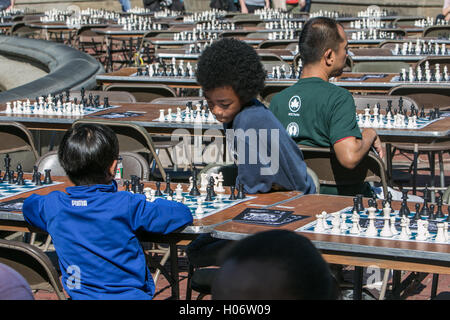 Two kids playing chess. - Stock Photo