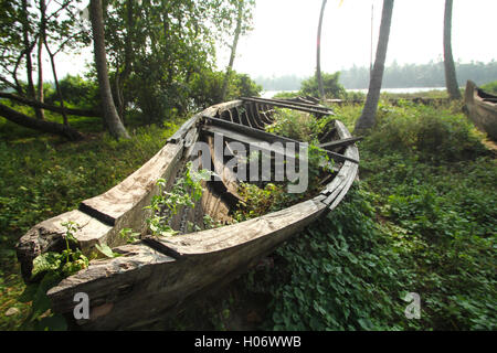 Damaged and Wrecked Traditional Wooden Kerala Boat . Old wooden country boat in Kerala India - Stock Photo