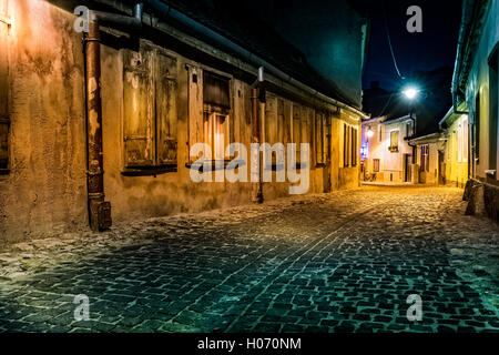 Dark deserted alley by night, in Sibiu, Romania (hollywood effect processing) - Stock Photo