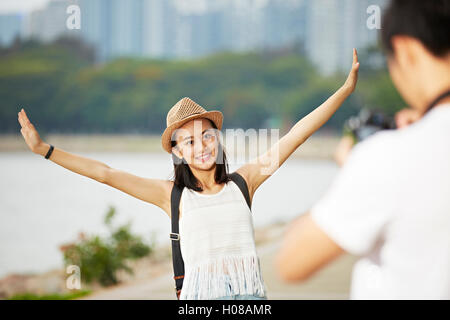 young couple tourists taking a travel photo - Stock Photo