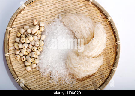Bird's nest or salanganes with lotus beans on a white background - Stock Photo