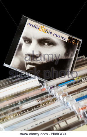Album The Very Best Of Sting & The Police CD pulled out from among rows of other CD's - Stock Photo