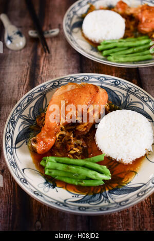 Vietnamese rice with fried chicken legs and green beans on the table - Stock Photo