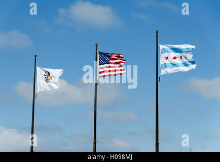 Illinois Flag, US Flag, and Chicago flag waving in strong breeze - Stock Photo