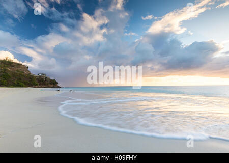 The sky turns pink at sunset and reflected on Ffryes Beach, Antigua, Antigua and Barbuda, Leeward Islands, West Indies