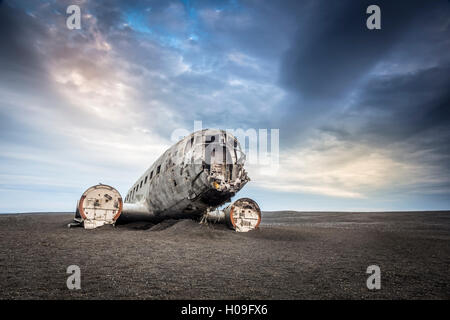 Wreckage of a United States Navy Douglas Super DC-3 that crashed on the black beach at Solheimasandur, South Region, - Stock Photo