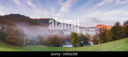 Panorama overlooking Horseshoe Falls with mist lying above the River Dee on an autumn morning, Denbighshire, Wales, - Stock Photo