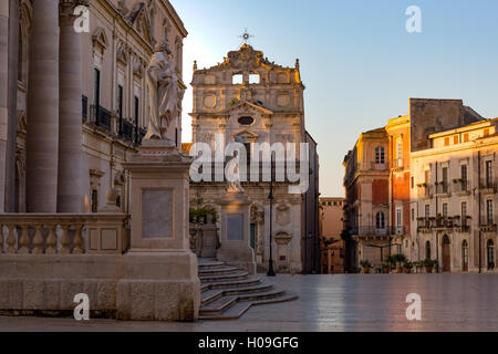 The Cathedral and Piazza Duomo in early morning on the tiny island of Ortygia, UNESCO, Syracuse, Sicily, Italy - Stock Photo