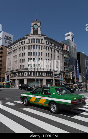 Taxi passing Wako department store in the Ginza district of Tokyo, Japan, Asia - Stock Photo