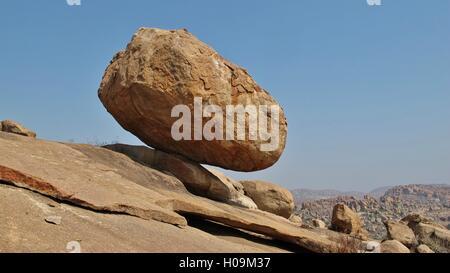 Big balancing granite boulder in Hampi, India. Popular area for bouldering. - Stock Photo