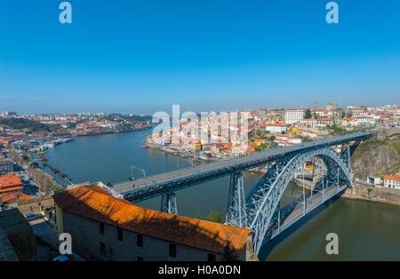View over Porto with bridge, Ponte Dom Luís I, across River Douro, sunset, Porto, Portugal - Stock Photo