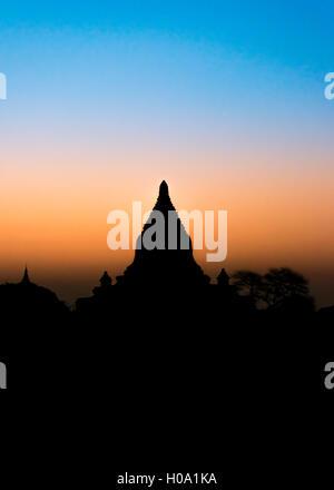 Pagoda in backlight, silhouette, temple, stupa, sunrise, morning atmosphere, Bagan, Division Mandalay, Myanmar - Stock Photo