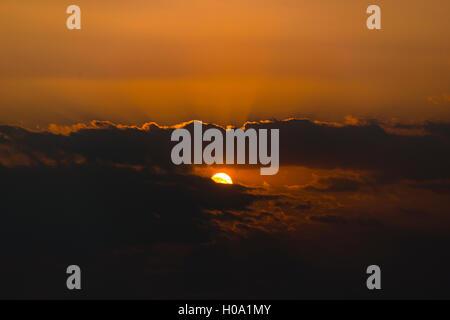 Sunset, sun shining through dark clouds, Mandalay Region, Myanmar