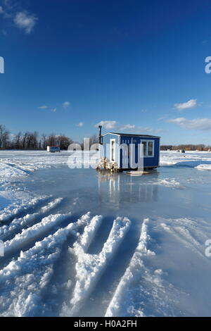 Ice fishing cabin on frozen Saint Lawrence River, Maple Grove, Quebec, Canada - Stock Photo