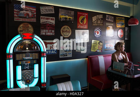 Jukebox, wall with old advertisements at a 50s style restaurant, Torsby, Värmland, Sweden - Stock Photo