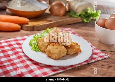 Plate of fish balls on the table in restaurant - Stock Photo