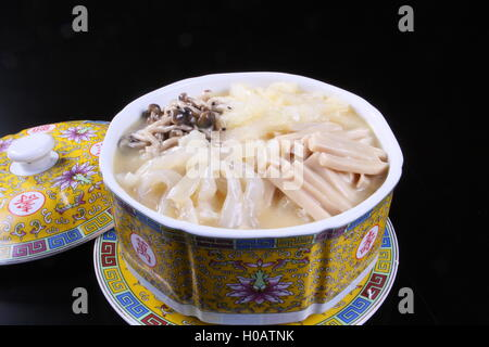 Mushroom soup in chinese bowl on black background - Stock Photo