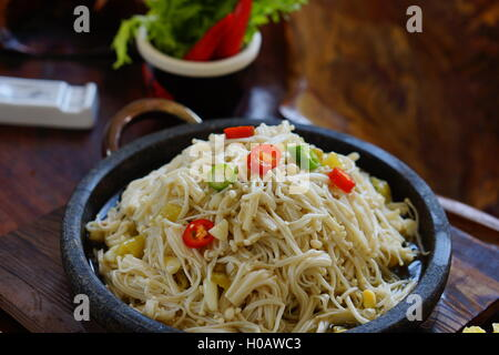 Fried mushroom with hot chili on stew in restaurant - Stock Photo