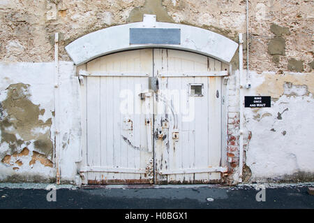 ... Old weathered doorway with sliding lock on the old limestone exterior at the Fremantle Prison in & Old Fremantle Prison. Fremantle Western Australia AUSTRALIA Stock ...