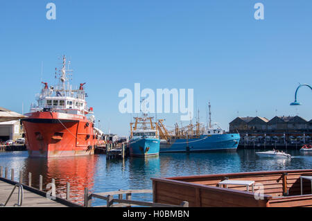 Fremantle,WA,Australia-June 1,2016: Fremantle Fishing Boat harbour with commercial fishing boats, and Kaili's Cafe - Stock Photo