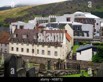 Scottish Parliament and Holyrood Park from New Calton Burial Ground Edinburgh Scotland - Stock Photo