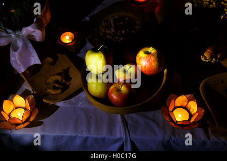 nocturnal feast held in nature with enchanting lotus shape cande holders. - Stock Photo
