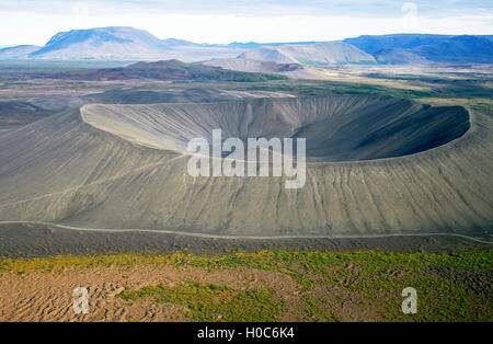 Deep crater seen from helicopter with other craters in the back. - Stock Photo