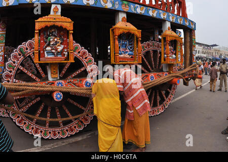 Puri, Odisha, India-July 2, 2011: Old devotee's praying to the idols assembled on chariot for The Jagannath Rath - Stock Photo