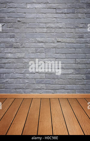 empty room interior with brick stone tiles wall and wood floor background - Stock Photo